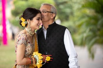 Photo of happy father and daughter shot on mehndi