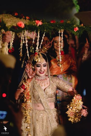 A bride in gold, dancing under the phoolon ki chadar