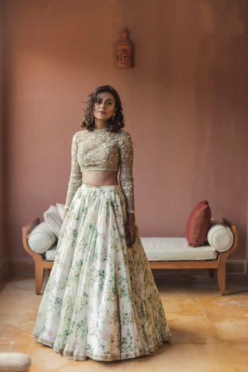 Floral print Sabyasachi lehenga in white and gold