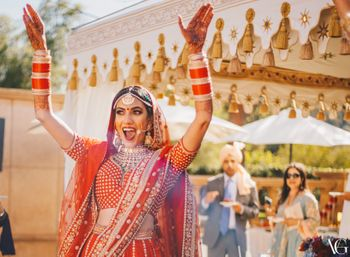 Photo of Bride in red looking radiant and happy