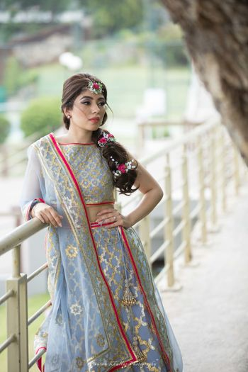 Photo of Ice blue and pink mehendi lehenga with floral braid