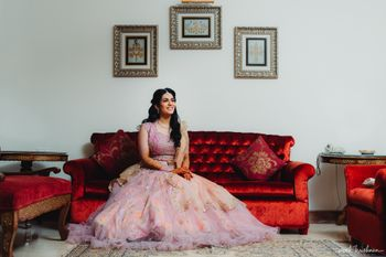 Bride in a dainty light pink lehenga for her engagement