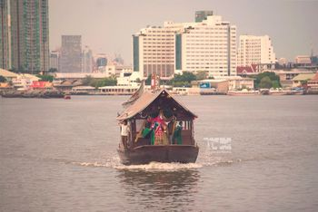 Photo of Bride entry on a shikara from across the lake