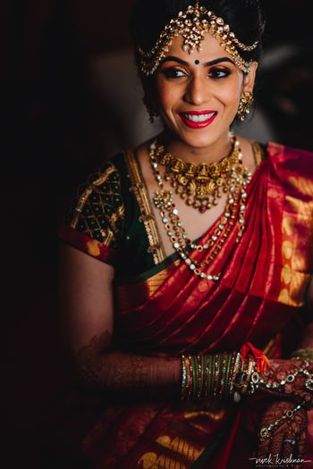 Photo of South indian bridal look with temple jewellery necklace