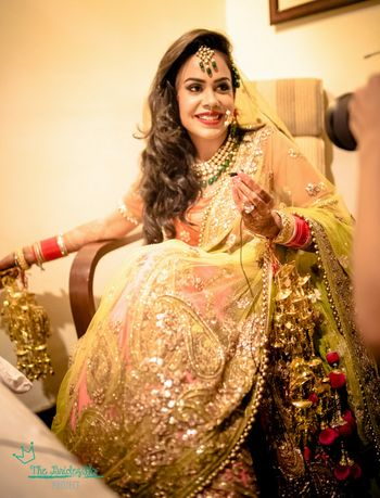 Photo of lime green and coral lehenga