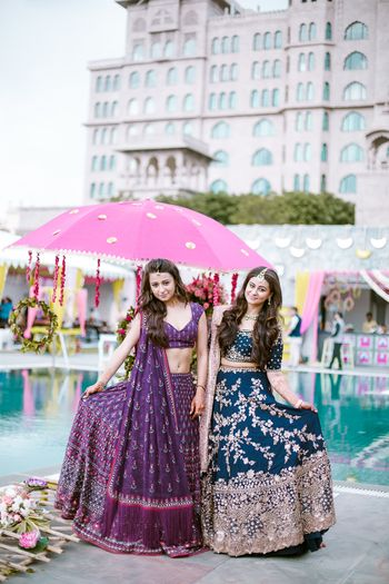 Sister of the bride in purple and teal lehengas