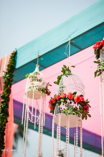 Photo of Hanging birdcages with crystals and flowers