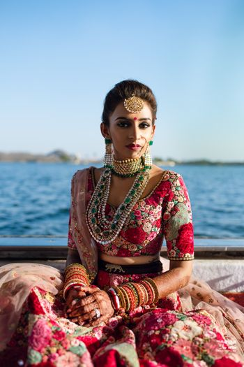 Photo of A perfect bridal portrait showcasing jewellery and lehenga