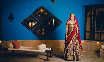 Photo of Maroon bridal lehenga with bronze work