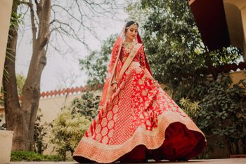 Red and gold Sabyasachi bridal lehenga