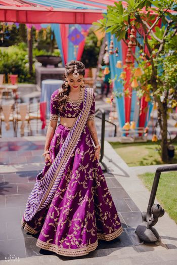 A bride in purple lehenga