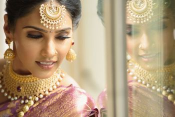 south indian bridal makeup with pink lids and nude lips