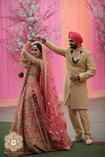 Photo of Pink and gold bridal lehenga