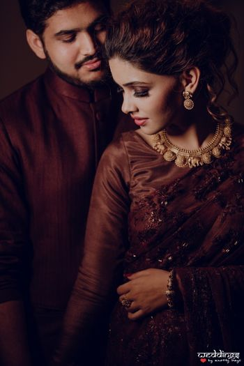 Engagement or sangeet couple portrait in brown