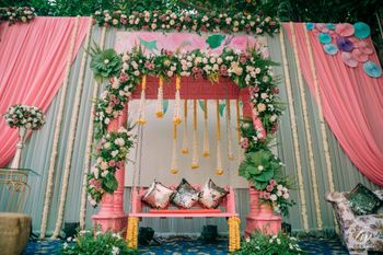 Photo of floral mehendi decor for bridal seat