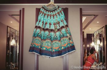 Teal and turquoise lehenga for sangeet on hanger
