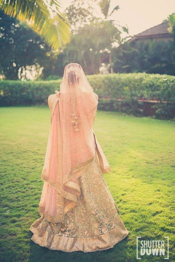 peach and pista green bridal lehenga