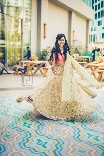 Photo of Peach and sage green mehendi lehenga