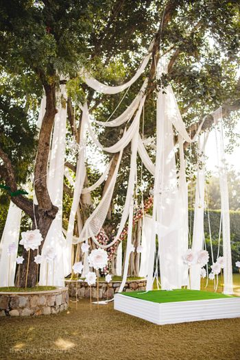 Tree decor with white drapes hanging from it