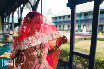 Bridal portrait with dupatta as veil