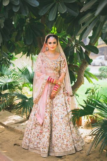 Floral embroidery cream and pink lehenga