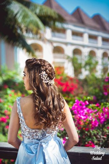 Open hairstyle with embellished pin for engagement