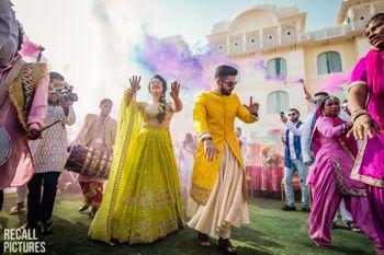 Mehendi holi party shot while couple enters