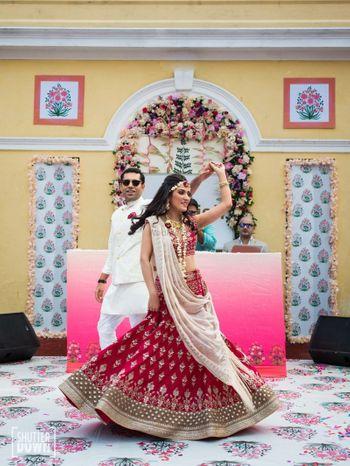 Bride and groom dancing on printed dance floor