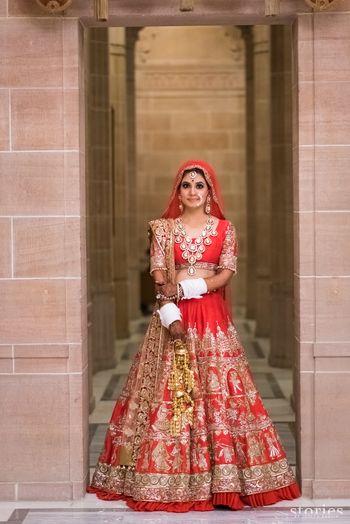 Red and gold bridal lehenga by manish malhotra