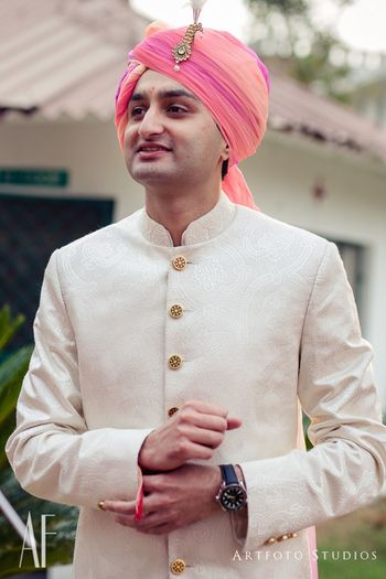 Photo of White sherwani with ombre pink safa
