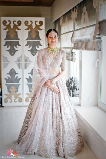 Photo of Bride in a pastel Falguni & Shane Peacock Lehenga