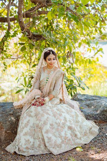 Pretty white and golden bridal lehenga for wedding