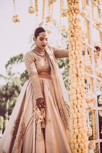 Beige bridal lehenga with full sleeves blouse