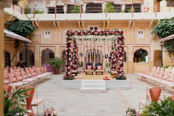 light pink minimal mandap decor with floral details