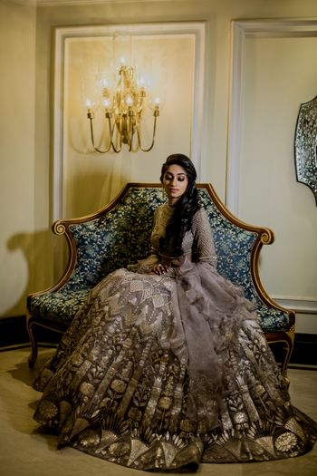 A bride to be in a mettalic lehenga for her sangeet