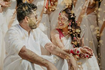 Photo of Cute candid shot of the couple on Haldi