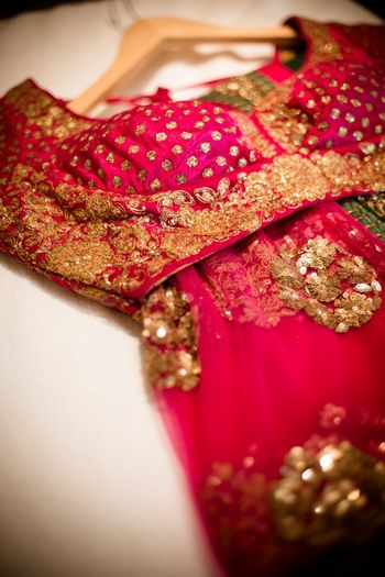 Photo of Sabyasachi bright pink blouse