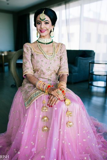 Sikh bride in light pink lehenga with long blouse