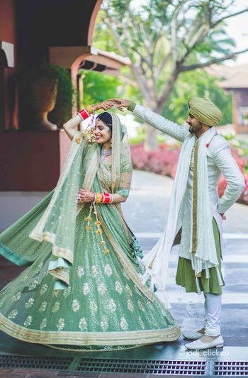 Coordinated bride and groom in sage green