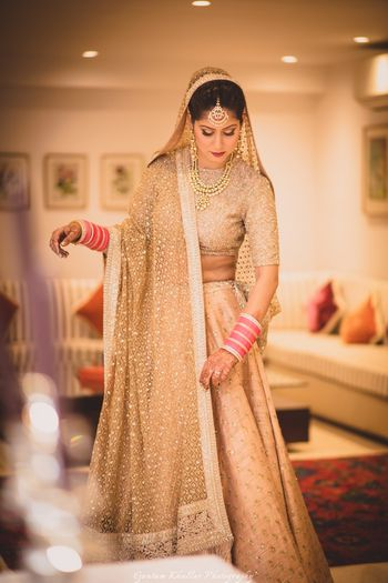 Offbeat bridal monotone gold lehenga for bride