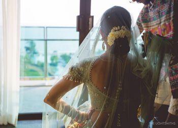 Photo of bridal bun with gajra flowers