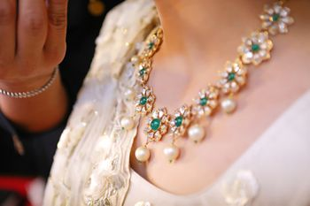 Simple bridal necklace with diamonds and emeralds