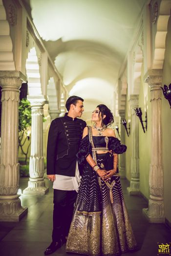 Black cocktail lehenga with ruffled off shoulder blouse