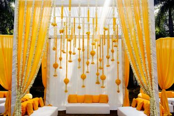 Mehendi yellow mandap seating idea