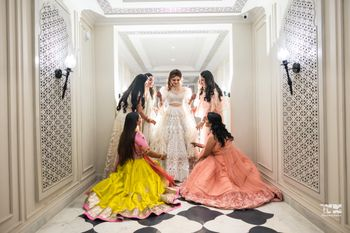 Photo of A bride poses with her bridesmaids on her sangeet day