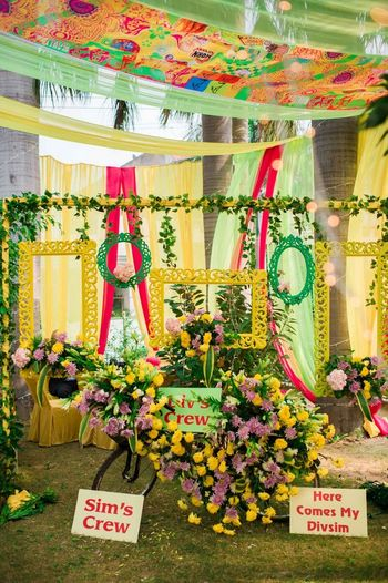 Photo of Yellow and green photobooth with frames