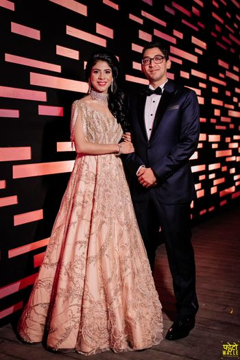 Photo of Sangeet gown couple portrait shot