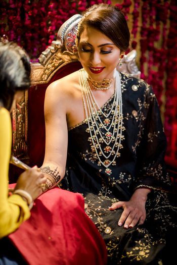 Bride wearing a black toga on her Sufi night.