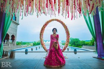 Bride on mehendi against simple photobooth