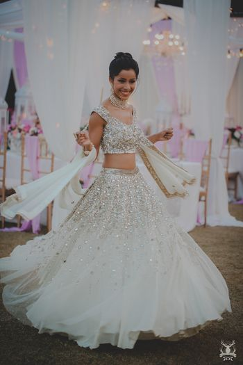 Photo of White and silver engagement lehenga